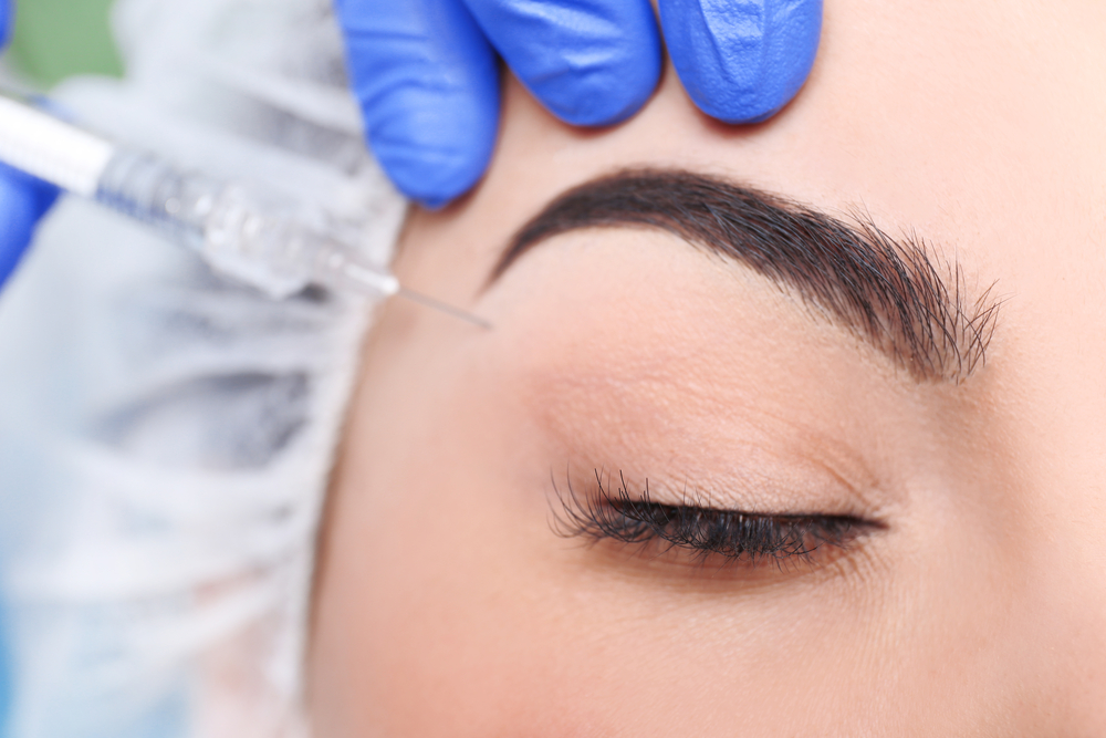 woman having botox brow lift injection
